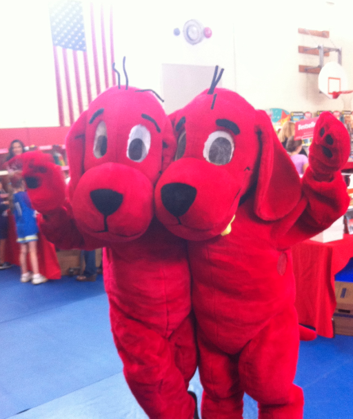 Me and another chump, dressed as Clifford at the Scholastic Book Fair. I'm the cranky looking one.